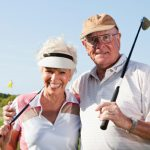 Senior couple, 70s, on the golf course.
